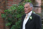 Father of the bride wearing a buttonhole flower