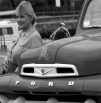 Lady in wren uniform leans against Ford pick-up truck
