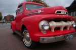 Bright red 1950s Ford pick-up truck