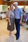 Couple in 1940s military uniforms pose for a photo