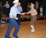 Couple in 1940s military uniform dancing