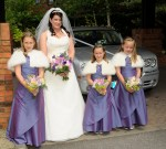 Bride and bridesmaids pose before entering the church