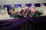 Wedding top table floral display with pink and purple flowers