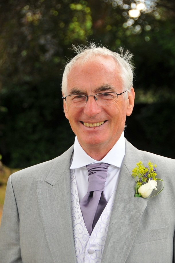Man in grey suit with ivory rose buttonhole