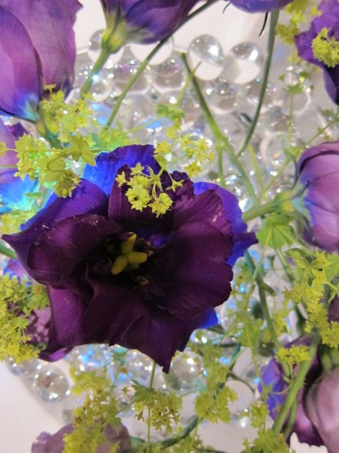Close-up view of purple rose inside wedding bouquet
