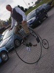Cyclist rides penny farthing