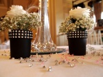 Two small rose tables decorations on table scattered with crystals